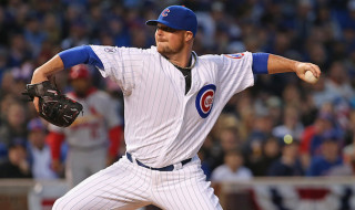 CHICAGO, IL - APRIL 05:  Starting pitcher Jon Lester #34 of the Chicago Cubs delivers the ball against the St. Louis Cardinals during the Opening Night game at Wrigley Field on April 5, 2015 in Chicago, Illinois. The Cardinals defeated the Cubs 3-0.  (Photo by Jonathan Daniel/Getty Images)